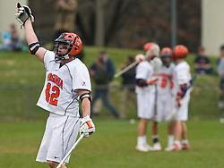 Virginia Cavaliers M Max Pomper (42) celebrates after a UVA goal against UMD.  The #9 ranked Maryland Terrapins fell to the #1 ranked Virginia Cavaliers 10 in 7 overtimes in Men's NCAA Lacrosse at Klockner Stadium on the Grounds of the University of Virginia in Charlottesville, VA on March 28, 2009.