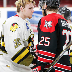 TRENTON, ON  - MAY 5,  2017: Canadian Junior Hockey League, Central Canadian Jr. &quot;A&quot; Championship. The Dudley Hewitt Cup. Game 7 between The Georgetown Raiders and The Powassan Voodoos. Nate McDonald #33 of the Powassan Voodoos and Jordan Anderson #25 of the Georgetown Raiders shake hands<br /> (Photo by Amy Deroche / OJHL Images)