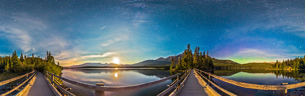 A 360&deg; night panorama, lit by moonlight, taken from the boardwalk out to Pryamid Island on Pyramid Lake in Jasper National Park. Contructed in the 1930s, the Boardwalk takes you to a popular picnic spot, Pyramid Island at the north end of Pyramid Lake. The view across the water to the surrounding mountains is wonderful by day and by night. By night, this is a fabulous place for stargazing in this Dark Sky Preserve. <br /> <br /> Here, south is at left, toward Mt. Edith Cavell. To the southwest, the waxing gibbous Moon is setting. At right of centre, the Boardwalk leads to Pyramid Island itself, with Pyramid Mountain behind it. Right of the island is the Big Dipper. To the right of the image, to the northeast, there&rsquo;s a weak aurora display. The Milky Way is faintly visible in the moonlit sky overhead. <br /> <br /> This an 8-segement panorama, taken with the 15mm full-frame fisheye lens and Canon 6D. Each segment was a 32-second exposure at f/2.8 and ISO 1250, stitched with PTGui.