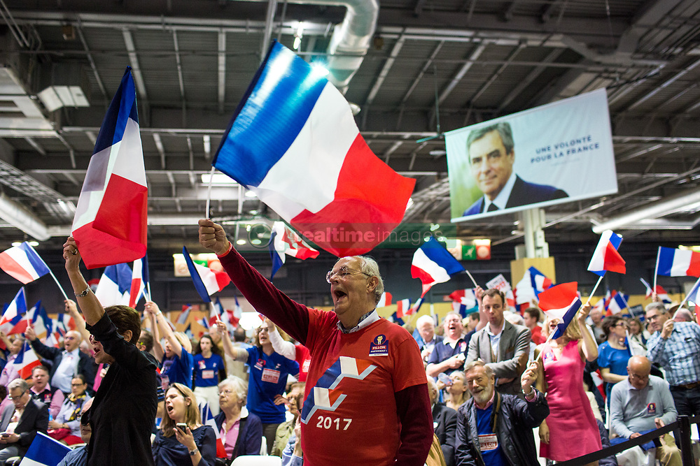 April 9, 2017 - Paris, France - Attendees hold French flags and placards before the start of an election campaign rally for Francois Fillon, France's presidential candidate, not pictured, in Paris, France, on Sunday, April 9, 2017. Presidential candidates Fillon and Jean-Luc Melenchon are rallying supporters on Sunday as polls suggest they're almost tied for third place with two weeks of campaigning left. (Credit Image: © Emeric Fohlen/NurPhoto via ZUMA Press)