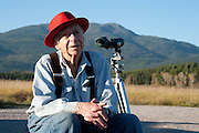 Bob Martin, 94, of Swan Lake viewing the mountains that he can no longer climb through his telescope.  Moved to Swan Lake at 16; married for 57 years up to 10 years ago; 2 sons.