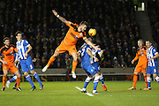 Ipswich Town defender Luke Chambers (4) wins the ball in the air during the Sky Bet Championship match between Brighton and Hove Albion and Ipswich Town at the American Express Community Stadium, Brighton and Hove, England on 29 December 2015. Photo by Phil Duncan.