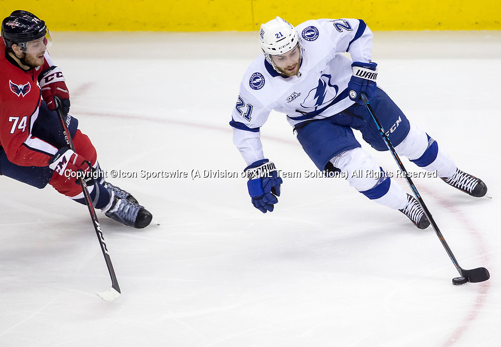 WASHINGTON, DC - MAY 21: Washington Capitals defenseman John Carlson (74) moves in on Tampa Bay Lightning center Brayden Point (21) during game 6 of the NHL Eastern Conference  Finals between the Washington Capitals and the Tampa Bay Lightning, on May 21, 2018, at Capital One Arena, in Washington D.C. The Caps defeated the Lightning 3-0<br /> (Photo by Tony Quinn/Icon Sportswire)