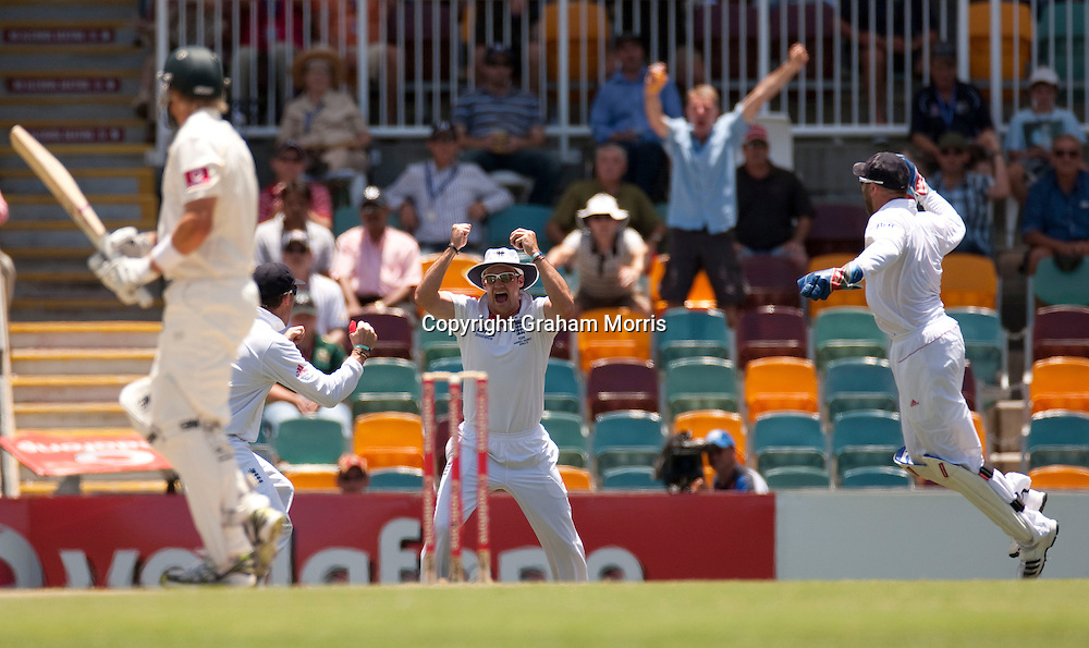 Captain Andrew Strauss (centre) celebrates catching Shane Watson off James Anderson during the first Ashes Test Match between Australia and England at the Gabba, Brisbane. Photo: Graham Morris (Tel: +44(0)20 8969 4192 Email: sales@cricketpix.com) 26/11/10