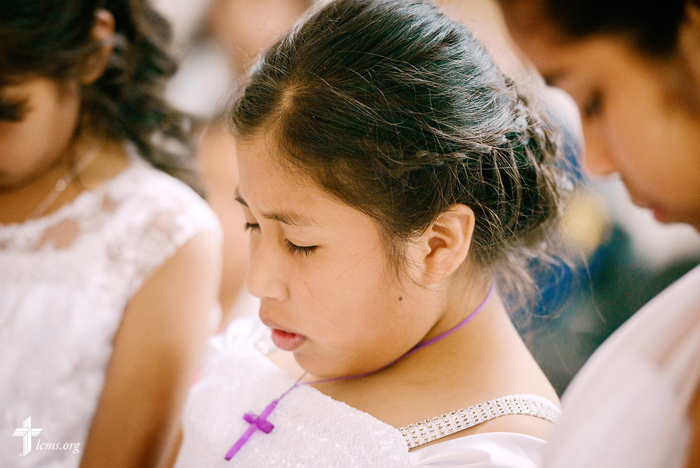 Margiory prays during her confirmation and worship service at Castillo Fuerte on Saturday, Nov. 4, 2017, in the La Victoria district of Lima, Peru. LCMS Communications/Erik M. Lunsford