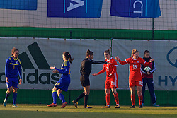 ZENICA, BOSNIA AND HERZEGOVINA - Tuesday, November 28, 2017: Wales'Alice Griffiths and Hayley Ladd Loren Dykes as referee Galiya Echeva awards an 84th minute penalty during the FIFA Women's World Cup 2019 Qualifying Round Group 1 match between Bosnia and Herzegovina and Wales at the FF BH Football Training Centre. (Pic by David Rawcliffe/Propaganda)