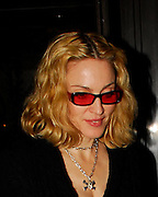25.SEPTEMBER.2007. LONDON<br /> <br /> A VERY GLUM AND GUANT LOOKING MADONNA LEAVING CECCONI'S RESTAURANT, MAYFAIR AT 11.30PM BY HERSELF AND SHE WAS WEARING A WEIRD PAIR OF ORANGE TINTED SUNGLASSES AND SKULL AND BONES NECKLACE. HER ARMS ALSO LOOK VERY SKINNY AND BONEY.<br /> <br /> BYLINE: EDBIMAGEARCHIVE.CO.UK<br /> <br /> *THIS IMAGE IS STRICTLY FOR UK NEWSPAPERS AND MAGAZINES ONLY*<br /> *FOR WORLD WIDE SALES AND WEB USE PLEASE CONTACT EDBIMAGEARCHIVE - 0208 954 5968*