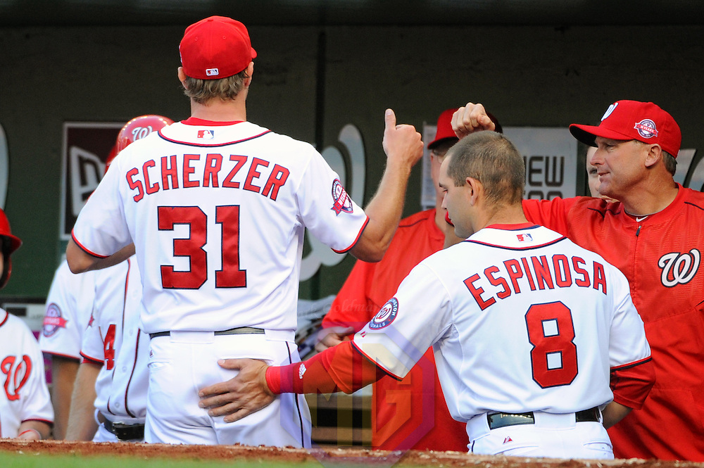 06 April 2015:  Washington Nationals starting pitcher Max Scherzer (31) is patted by second baseman Danny Espinosa (8) after leaving the game on opening day at Nationals Park in Washington, D.C. where the New York Mets defeated the Washington Nationals, 3-1.