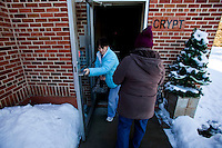 "CHAMPION, WI - DECEMBER 22: Theresa Vandermause, left, of Thiry Dames Wis. holds the door for Judy Deprey, right, of Dyckesville Wis. as they go to pray to the Blessed Virgin Mary at the Shrine of Our Lady of Good Help in a small rural town in northern Wisconsin, December 22, 2010 in Champion, Wisconsin. After years of research, the Bishop of Green Bay determined that the sightings of Mary ""clothed in dazzling white"" are indeed ""worthy of belief"" and now have now been officially sanctioned as real by the Vatican. This shrine is the first of such for the United States and now joins the company of Lourdes and Fatima.   (Darren Hauck)"