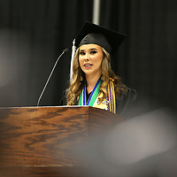 Mooreville Valedictorian Anna Cate McLarty addresses her class during the Mooreville High School graduation ceremony Saturday.