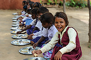 A child enjoying her school lunch - shot for WaterAid in India