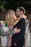 SUKI WATERHOUSE; BRADLEY COOPER, 2014 Serpentine's summer party sponsored by Brioni.with a pavilion designed this year by Chilean architect Smiljan Radic  Kensington Gdns. London. 1July 2014