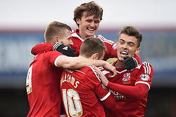 Swindon players celebrate with Andy Williams in the Sky Bet League One match between Swindon Town and Chesterfield at The County Ground on January 17, 2015 in Swindon, England. - Photo mandatory by-line: Paul Knight/JMP - Mobile: 07966 386802 - 17/01/2015 - SPORT - Football - Swindon - The County Ground - Swindon Town v Chesterfield - Sky Bet League One