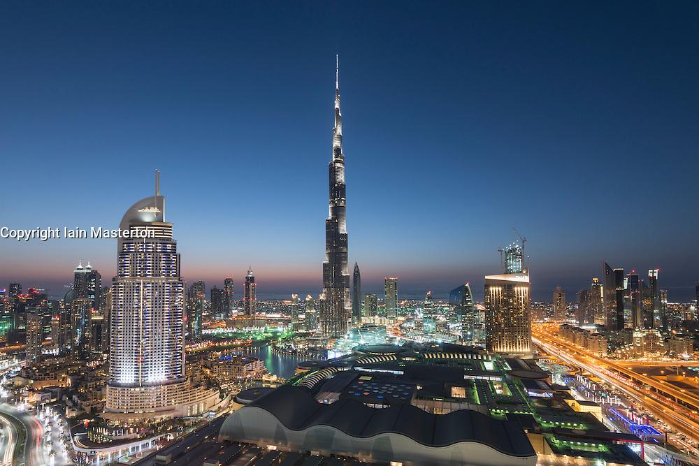 Burj Khalifa , the Dubai Mall and skyline of Downtown Dubai at night in United Arab Emirates
