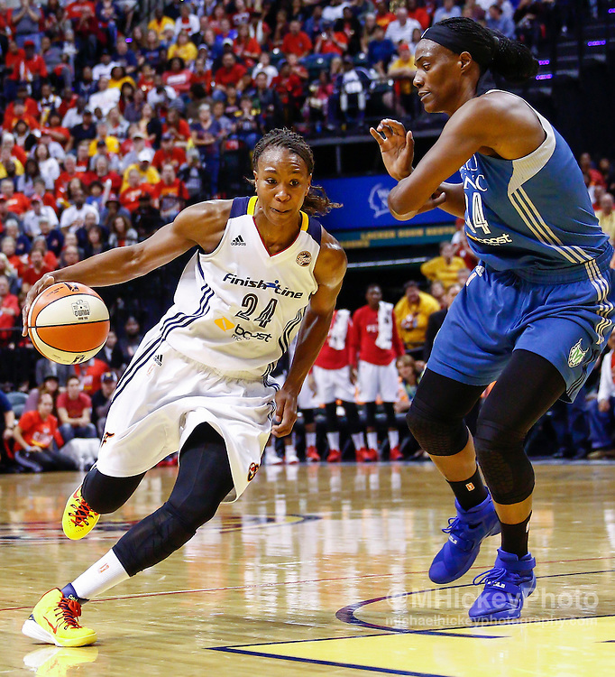 INDIANAPOLIS, IN - OCTOBER 11: Tamika Catchings #24 of the Indiana Fever dribbles the ball around Sylvia Fowles #34 of the Minnesota Lynx at Bankers Life Fieldhouse on October 11, 2015 in Indianapolis, Indiana. Indiana defeated Minnesota 75-69. NOTE TO USER: User expressly acknowledges and agrees that, by downloading and or using this photograph, User is consenting to the terms and conditions of the Getty Images License Agreement. (Photo by Michael Hickey/ Getty Images) *** Local Caption *** Tamika Catchings; Sylvia Fowles