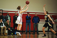 CVU's Sadie Otley (3) takes a shot during the girls basketball game between the Essex Hornets and the Champlain Valley Union Redhawks at CVU high school on Tuesday night January 26, 2016 in Hinesburg. (BRIAN JENKINS/for the FREE PRESS)