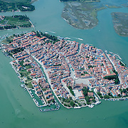 VENICE, ITALY - JULY 07:   A general view of the Island of Burano seen during the Seawing  tour above Venice on July 7, 2011 in Venice, Italy. Seawings has started a new tour of Venice by seaplane, offering aerial views of the Venetian Lagoon and its historic islands, continuing a long history of seaplanes in Venice.