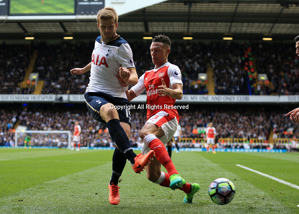 April 30th 2017, White Hart Lane, Tottenham, London England; EPL Premier League football Tottenham Hotspur versus Arsenal; Eric Dier of Tottenham Hotspur being intercepted by Kieran Gibbs of Arsenal