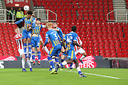Peter Crouch for Stoke City and  20 Aaron Holloway for Shrewsbury Town challenge for the ball during the The FA Cup 3rd round replay match between Stoke City and Shrewsbury Town at the Bet365 Stadium, Stoke-on-Trent, England on 15 January 2019.