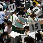 TOKYO, JAPAN - JULY 10 : Election staff members open the ballot boxes to begin counting the votes, for Parliament's upper house elections at a ballot counting center in Tokyo, Japan, Sunday, July 10, 2016. (Photo by Richard Atrero de Guzman/NUR Photo)