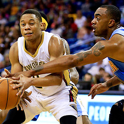Mar 31, 2016; New Orleans, LA, USA; Denver Nuggets forward Darrell Arthur (00) knocks the ball away from New Orleans Pelicans guard Tim Frazier (2) during the second half of a game at the Smoothie King Center. The Pelicans defeated the Nuggets 101-95. Mandatory Credit: Derick E. Hingle-USA TODAY Sports