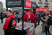 Marketing workers with Coca-Cola hand out samples of their new Zero Sugar (Sugar Free) drinks to passers-by in Piccadilly Circus, on 16th April 2018, in London, England.