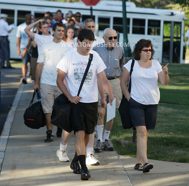New cadets and their family walk to Eisenhower Hall for the start of Reception Day at the U.S. Military Academy at West Point on Monday, July 2, 2012.