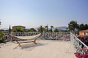 hammock on the balcony of a Summer vacation home on the French Riviera, Sainte-Maxime, France