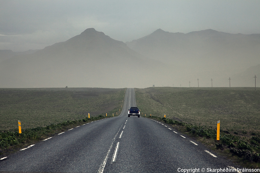 The highway in southern Iceland. Ash cloud in the air after erupting volcano in Grímsvötn