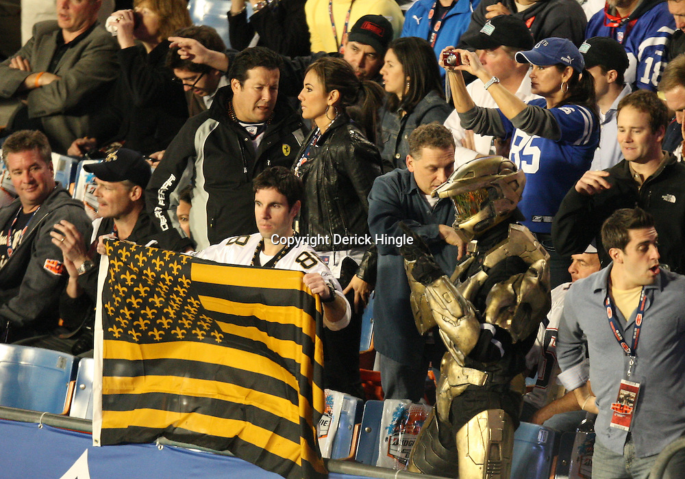 2010 February 07: New Orleans Saints fans cheer from the stands during a 31-17 win by the New Orleans Saints over the Indianapolis Colts in Super Bowl XLIV at Sun Life Stadium in Miami Gardens, Florida.