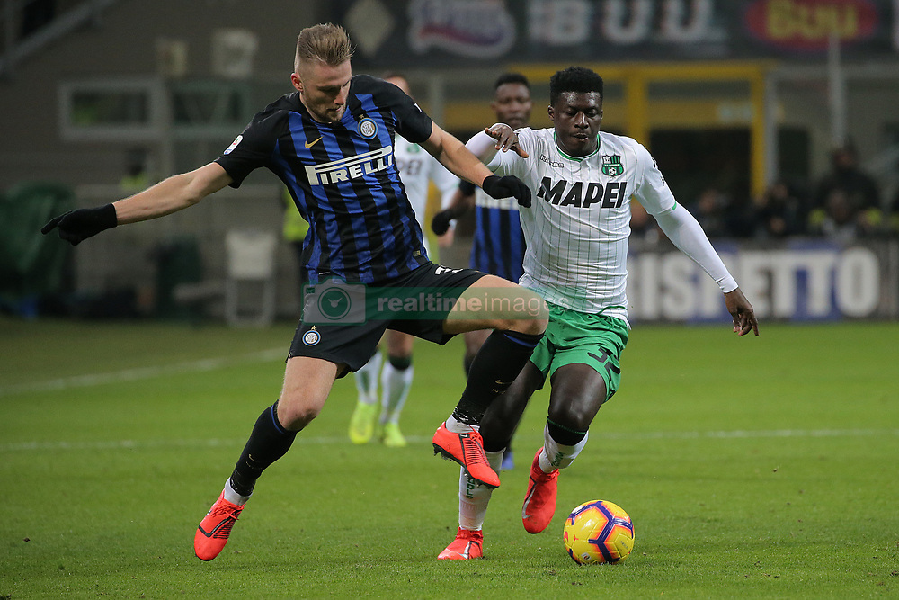 January 19, 2019 - Milan, Milan, Italy - Milan Skriniar #37 of FC Internazionale Milano competes for the ball with Alfred Duncan #32 of US Sassuolo during the serie A match between FC Internazionale and US Sassuolo at Stadio Giuseppe Meazza on January 19, 2019 in Milan, Italy. (Credit Image: © Giuseppe Cottini/NurPhoto via ZUMA Press)