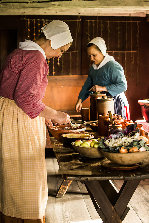 Women preparing a meal during Fall Flavors at Greenfield Village.  Photographed by KMS Photography