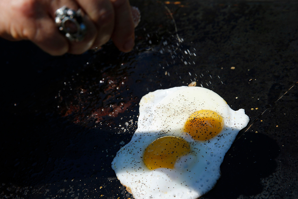Kendra Kolling adds salt to a couple eggs for her The Works sandwhich at The Barlow on Tuesday, Aug. 22, 2017, in Sebastopol, Calif.