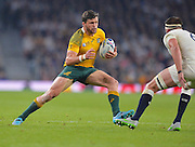 Adam Ashley-Cooper looks to evade a tackler during the Rugby World Cup Pool A match between England and Australia at Twickenham, Richmond, United Kingdom on 3 October 2015. Photo by Ian Muir.during the Rugby World Cup Pool A match between England and Australia at Twickenham, Richmond, United Kingdom on 3 October 2015. Photo by Ian Muir.