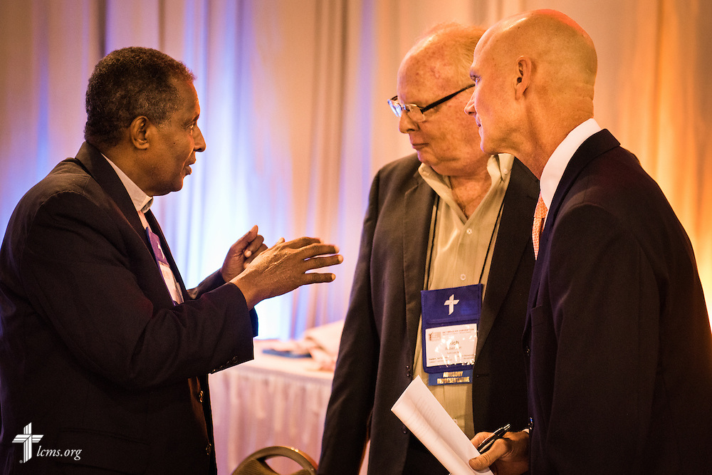 Richard Robertson, middle, president and CEO of Lutheran Church Extension Fund, and Tom Buuck, right, CEO of Lutheran Federal Credit Union, speak with Rev. Dr. Berhanu Ofgaa, general secretary of the Ethiopian Evangelical Church Mekane Yesus, on Wednesday, July 13, 2016, at the 66th Regular Convention of The Lutheran Church–Missouri Synod, in Milwaukee. LCMS/Frank Kohn