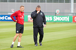 NEWPORT, WALES - Monday, August 12, 2013: Wales' Craig Bellamy and coach Osian Roberts training at the FAW National Development Centre at Dragon Park ahead of the International friendly against the Republic of Ireland. (Pic by David Rawcliffe/Propaganda)