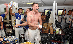 Lee Brown of Bristol Rovers celebrates promotion from Sky Bet League 2 up to Sky Bet League 1 in the dressing room  - Mandatory by-line: Joe Meredith/JMP - 07/05/2016 - FOOTBALL - Memorial Stadium - Bristol, England - Bristol Rovers v Dagenham and Redbridge - Sky Bet League Two
