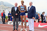 Yulimar Rojas (VEN), center, poses with Prince Albert II aka  Albert Alexandre Louis Pierre Grimald (right) and EBS president Gregor Bencina after winning the women's triple jump at 49-1 3/4  (14.98m) in the  Herculis Monaco in an IAAF Diamond League meet , Thursday, July 11, 2019, in Port Hercules, Monaco.(Jiro Mochizuki/Image of Sport)