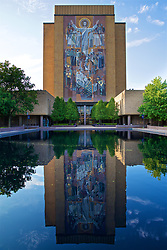 SOUTH BEND, INDIANA, USA - Thursday, July 18, 2019: A large mural entitled The Word of Life by Millard Sheets of the resurrected Jesus installed in 1964 on the Hesburgh Library of Notre Dame University. It has the nickname Touchdown Jesus derived from Jesus' upraised arms, which are similar in appearance to the raised arms of a referee signifying a touchdown in American gridiron football. (Pic by David Rawcliffe/Propaganda)