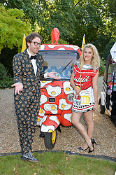 PHILIP COLBERT and ASHLEY ROBERTS at the Quintessentially Foundation and Elephant Family 's 'Travels to My Elephant' Royal Rickshaw Auction presented by Selfridges and hosted by HRH The Prince of Wales and The Duchess of Cornwall held at Lancaster House, Cleveland Row, St.James's, London on 30th June 2015.
