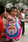 Beijing Zoo. Child with cat balloon.