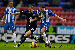 WIGAN, ENGLAND - Sunday, January 20, 2008: Everton's Phil Jagielka and Wigan Athletic's Michael Brown during the Premiership match at the JJB Stadium. (Photo by David Rawcliffe/Propaganda)