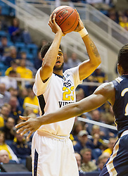 Nov 11, 2016; Morgantown, WV, USA; West Virginia Mountaineers forward Esa Ahmad (23) passes the ball during the second half against the Mount St. Mary's Mountaineers at WVU Coliseum. Mandatory Credit: Ben Queen-USA TODAY Sports