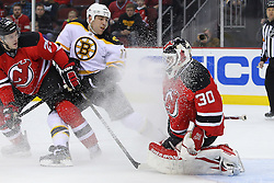 Jan 4, 2012; Newark, NJ, USA; New Jersey Devils goalie Martin Brodeur (30) is snowed while making a save by Boston Bruins left wing Milan Lucic (17) during the first period at the Prudential Center.