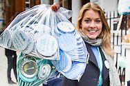 A woman holds out badges for supporters as striking junior doctors picket outside Great Ormond Street Hospital for Children, Bloomsbury, London.<br /> Picture by Paul Davey/Focus Images Ltd +447966 016296<br /> 26/04/2016