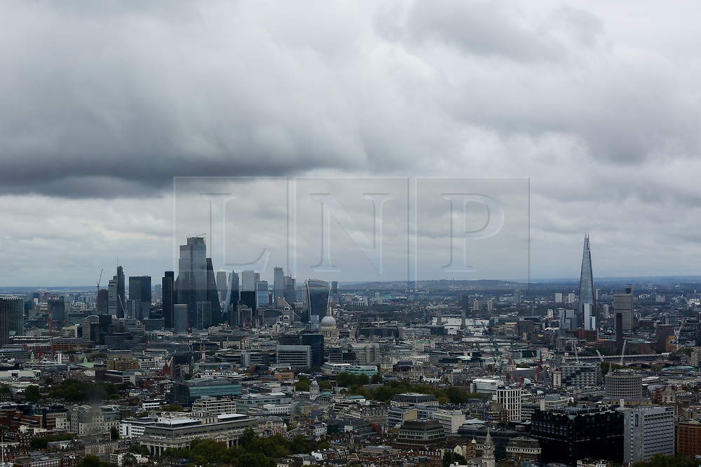© Licensed to London News Pictures. 22/09/2019. London, UK. An aerial view of London showing dark rain clouds over London financial district and The Shard seen from BT Tower. Photo credit: Dinendra Haria/LNP