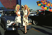 Retro 1950's girls and cars outside a casino. Las Vegas, USA, 2000's