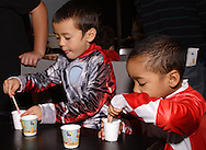 Jaeden Alvarez, 5 (left) and Shaun Hinesman, 3, both of Centerville work on some slime in the Monster Lab during Howl-O-Ween 2010 at the Boonshoft Museum of Discovery in Dayton, Saturday, October 23, 2009..