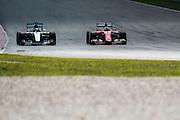 March 27-29, 2015: Malaysian Grand Prix - Sebastian Vettel (GER), Ferrari passes Lewis Hamilton (GBR), Mercedes