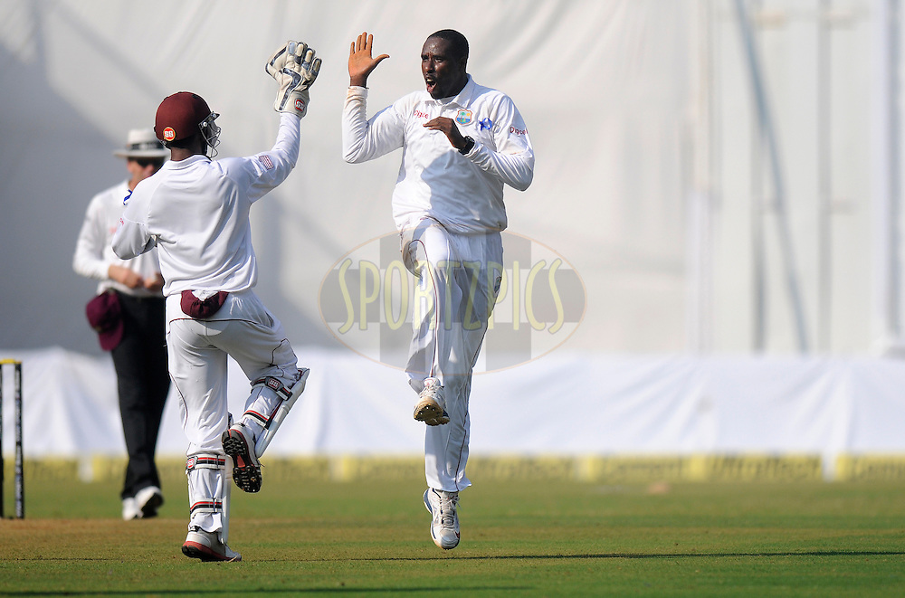 Shane Shillingford of West Indies celebrates the wicket of Murali Vijay of India during day one of the second Star Sports test match between India and The West Indies held at The Wankhede Stadium in Mumbai, India on the 14th November 2013<br /> <br /> This test match is the 200th test match for Sachin Tendulkar and his last for India.  After a career spanning more than 24yrs Sachin is retiring from cricket and this test match is his last appearance on the field of play.<br /> <br /> Photo by: Pal PIllai - BCCI - SPORTZPICS<br /> <br /> Use of this image is subject to the terms and conditions as outlined by the BCCI. These terms can be found by following this link:<br /> <br /> http://sportzpics.photoshelter.com/gallery/BCCI-Image-Terms/G0000ahUVIIEBQ84/C0000whs75.ajndY